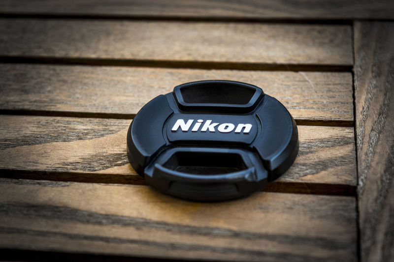 Thank you my dear lens cap for being always with me caring for my beautiful lens. This shoot is specially for you dud. :) Camera Nikon Nikon Camera Wood Camera Gear Cap Lens Nikon Lens Nikon Lens Cap Nikonphotography No People Protect Protection Table Wooden