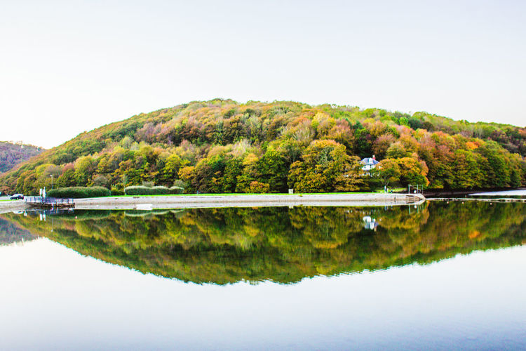 Reflection Lake Water Standing Water Tranquility Nature Symmetry Scenics Beauty In Nature Tree Landscape Outdoors No People Sky Rural Scene Day Boat Cloud - Sky Water Reflections Beauty In Nature Reflection Tranquility Tree Looe
