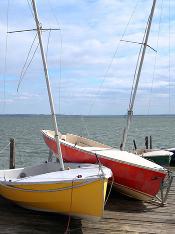The contrast of red and yellow was so beautiful.. I had to wait a while to take the shot though, as a little boy was exploring them. Colourful Framing Low Angle View Beach Blue Blue Sky Boat Cloud - Sky Dock Docks Horizon Horizon Over Water Mode Of Transportation Moored Nature Nautical Vessel No People Sailboat Scenics - Nature Sea Seaside Sky Southend Transportation Water