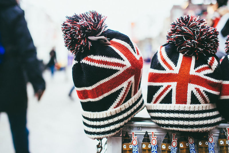 Close-Up Of Knit Hats With British Flags On Street For Sale