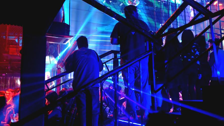 People standing in illuminated nightclub