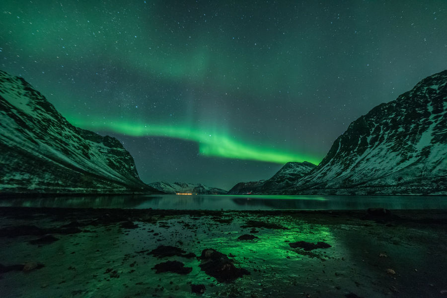 The northern lights reflecting on both water and ice at my favourite fjord in the area, Grotfjørd Aurora Borealis Ice Northern Lights Norway Reflection Astronomy Aurora Polaris Beauty In Nature Cold Temperature Landscape Mountain Nature Night No People Outdoors Reflections Scenics Sky Snow Star - Space Tranquil Scene Tranquility Water Waterfront Winter