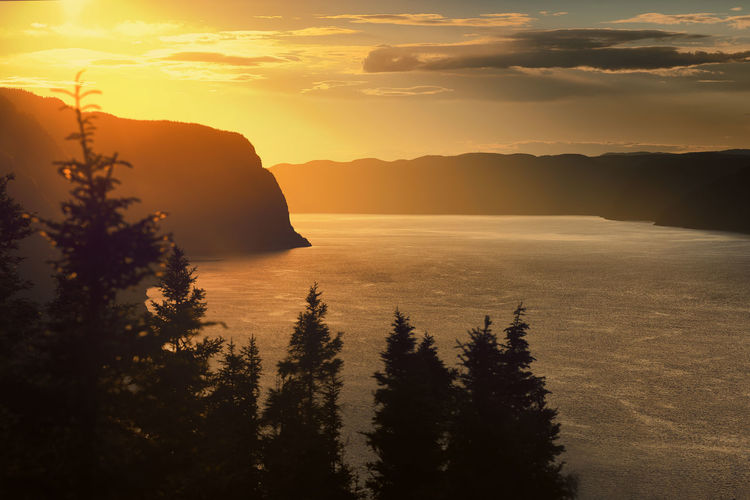 The view Quebec Beauty In Nature Day Idyllic Mountain Nature No People Outdoors Scenery Scenics Sea Silhouette Sky Sunset Tranquil Scene Tranquility Tree Water