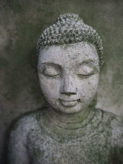Buddha Meditation Sacred Places Spirituality Art And Craft Belief Buddha Head Carving - Craft Product Close-up Craft Creativity Human Representation Male Likeness No People Old Religion Representation Sculpture Solid Spirituality Statue Stone Stone Material
