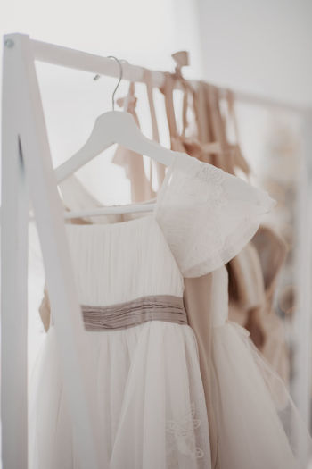 Close-up of mannequin hanging on white wall