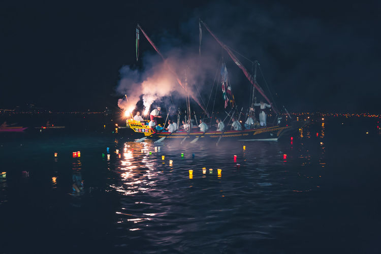 Stella Maris Tradition Arts Culture And Entertainment Boat Celebration Event Illuminated Large Group Of People Night Outdoors People Real People Sea Water Waterfront The Week On EyeEm EyeEm Selects Candles Italy 🇮🇹 Storic Floating On Water Floating Candles Night Lights EyeEmNewHere An Eye For Travel HUAWEI Photo Award: After Dark #urbanana: The Urban Playground