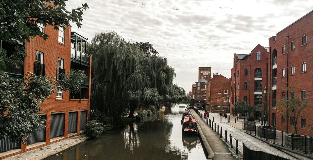 A Canal in Chester ... Architecture Building Exterior Sky Built Structure Reflection Tree Water City No People Travel Destinations Outdoors Cloud - Sky Day Boat Long Boat Canal Boat Orange Color Bricks British Britain England, UK Uk Town