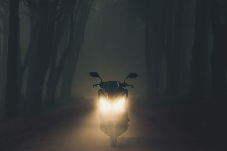 Silhouette of a motorcycle in the forest