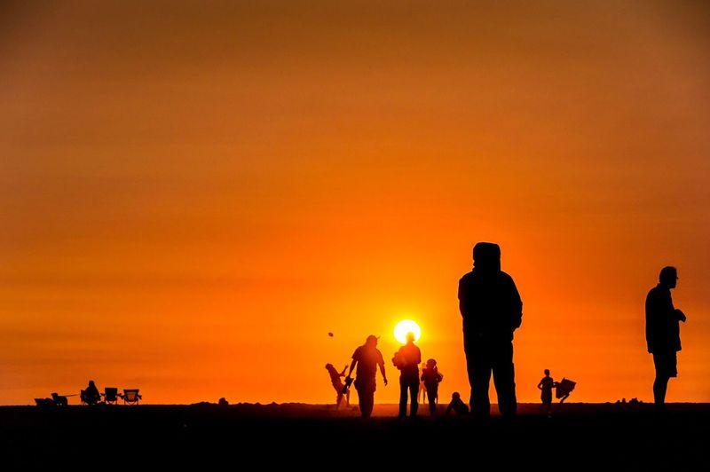 Beach fun at sunset. Sunset Silhouette Orange Color Large Group Of People The Week On EyeEm Neskowin Oregon Coast Beach PNW Oregon Outdoors Tranquil Scene
