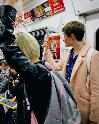 People traveling in subway train