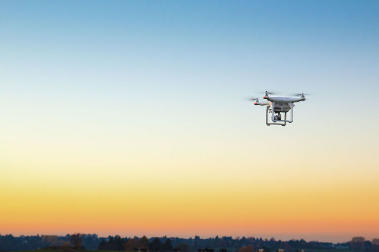 Drone  Aerospace Industry Air Vehicle Airplane Clear Sky Copy Space Drone  Drone Photography Dronephotography Flying Futuristic Low Angle View Media Equipment Mid-air Mode Of Transportation Motion Nature No People Sky Sunset Surveillance Technology Transportation Travel Uav