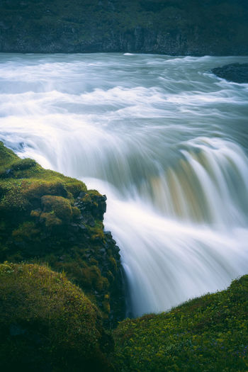 Closeup view of flowing water stream at gulfoss waterfall, golden circle iceland