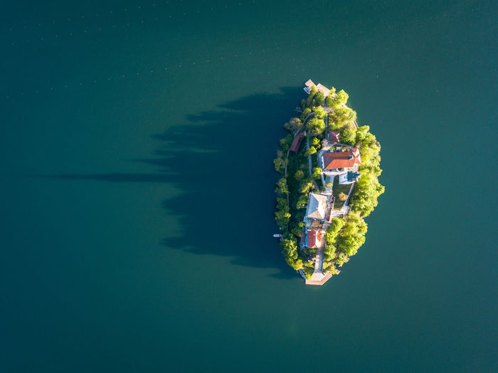 Water Waterfront Sea Nature Nautical Vessel Reflection No People Outdoors Transportation Day Beauty In Nature Mode Of Transportation High Angle View Blue Floating Directly Above Floating On Water Tranquility