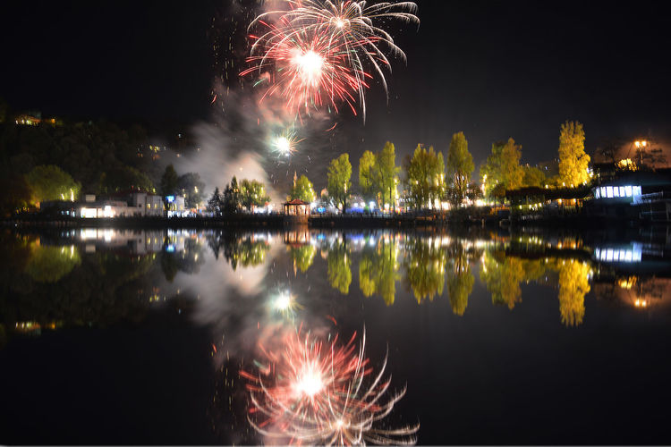 Fireworks on lake side.. Firework Reflections Fireworks Celebration Event Exploding Firework Firework - Man Made Object Firework Display Illuminated Light Night Reflection Waterfront