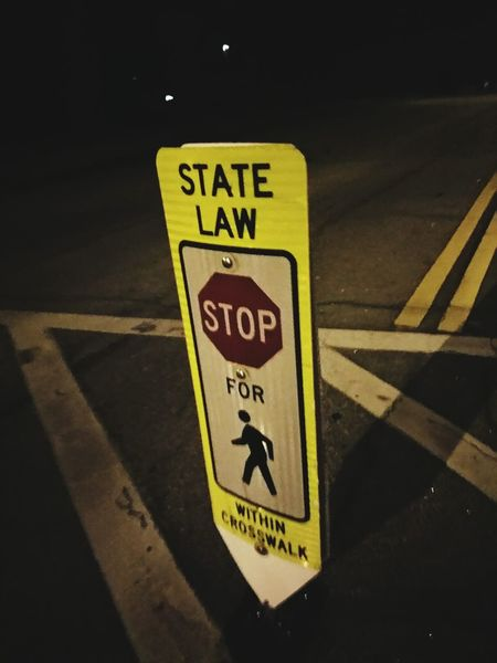 Street Photography Night Photography Stop Sign Warning Sign State Law Stop Stop For Pedestrians Crosswalk Street Signs The Law Safety First The City Light Resist Art Is Everywhere Break The Mold The Street Photographer - 2017 EyeEm Awards Connected By Travel