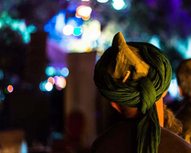 Rear view of man with miswak in turban