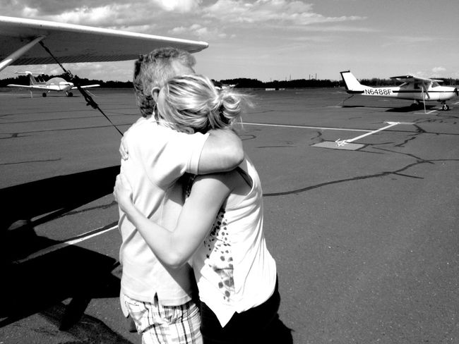 QVHoughPhoto Wisconsin Superior RichardIBongAirport Hug Embrace Goodbye Blackandwhite Airport Blackandwhite IPhoneography IPhone4s