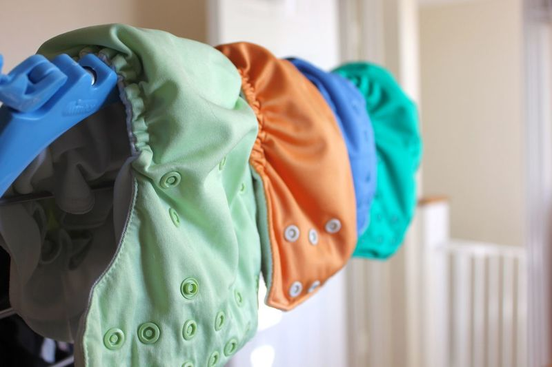 reusable nappies / diapers drying on rack Eco Baby Care Baby Needs Blue Close-up Clothing Day Drying Environmental Conservation Environmentally Friendly Indoors  No People Reusable Reusable Diaper Reusable Nappy