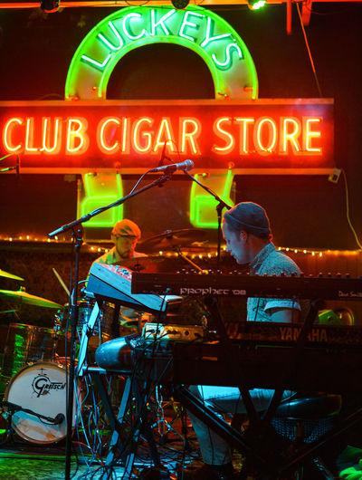 Dandu on stage. Stage Band Live Music Eugene Oregon Nightlife Text Western Script Close-up