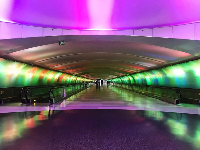 Eye4photography  EyeEm Selects EyeEmNewHere EyeEm Best Shots Tunnel Of Light Tunnel Illuminated Indoors  Architecture Lighting Equipment Built Structure Pink Color The Way Forward Multi Colored Light Modern Purple Direction