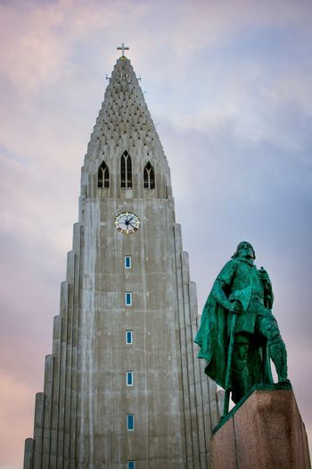 Hallgrímskirkja and the Leif Erikson statue, Reykjavík Reykjavík, Iceland Reykjavik Iceland Travel Photography Travel Destinations Leifur Eiriksson Leif Eriksson Statue Leif Eriksson Hallgrimskikja Church Hallgrìmskirkja Sky Architecture Sculpture Statue Human Representation Building Exterior Built Structure Representation Low Angle View Religion Spirituality Cloud - Sky Building Travel Destinations Belief Place Of Worship No People Spire