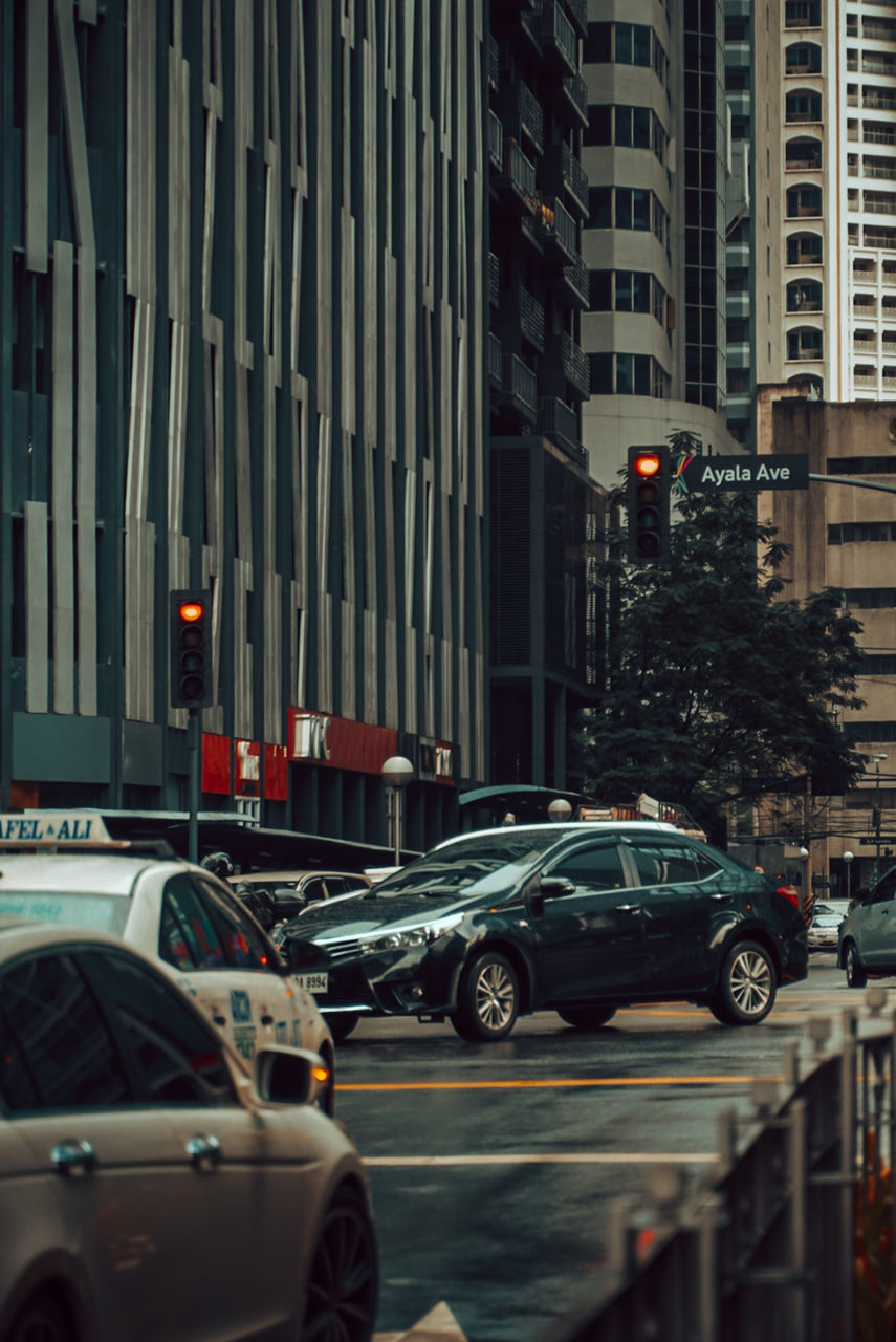 TRAFFIC ON ROAD IN CITY BUILDINGS