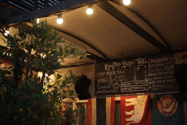 Information sign in illuminated restaurant