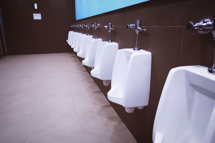 Absence Arrangement Bathroom Chair Clean Domestic Bathroom Domestic Room Empty Flooring Hygiene In A Row Indoors  Luxury No People Relaxation Seat Setting Side By Side Table Tile Toilet White White Color