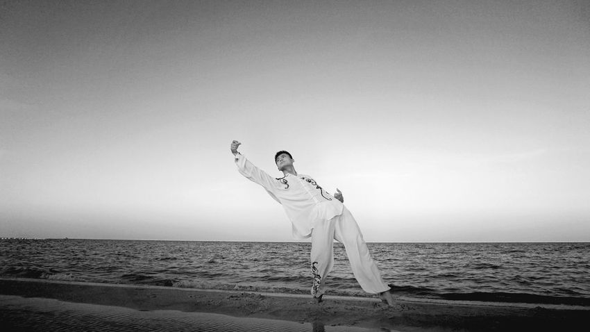 chinese kungfu Chinese Kungfu Sand Arms Raised Beauty In Nature Horizon Over Water Adult Holiday Horizon Vacations Copy Space Women Trip Human Arm Limb