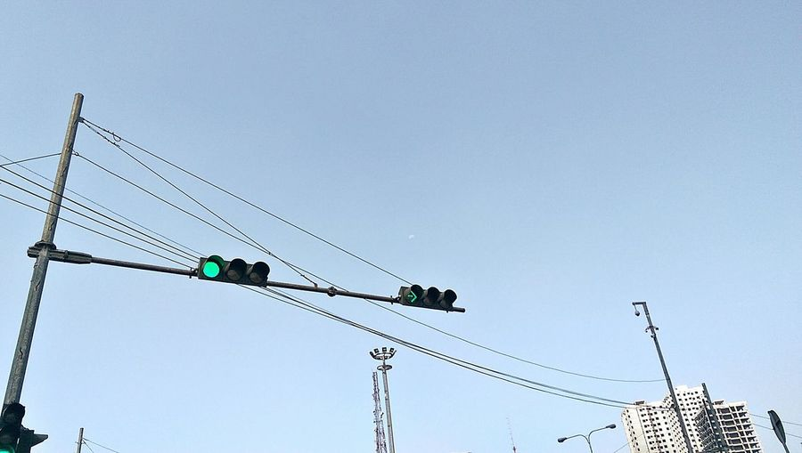 Low Angle View Of Traffic Signal Against Clear Sky