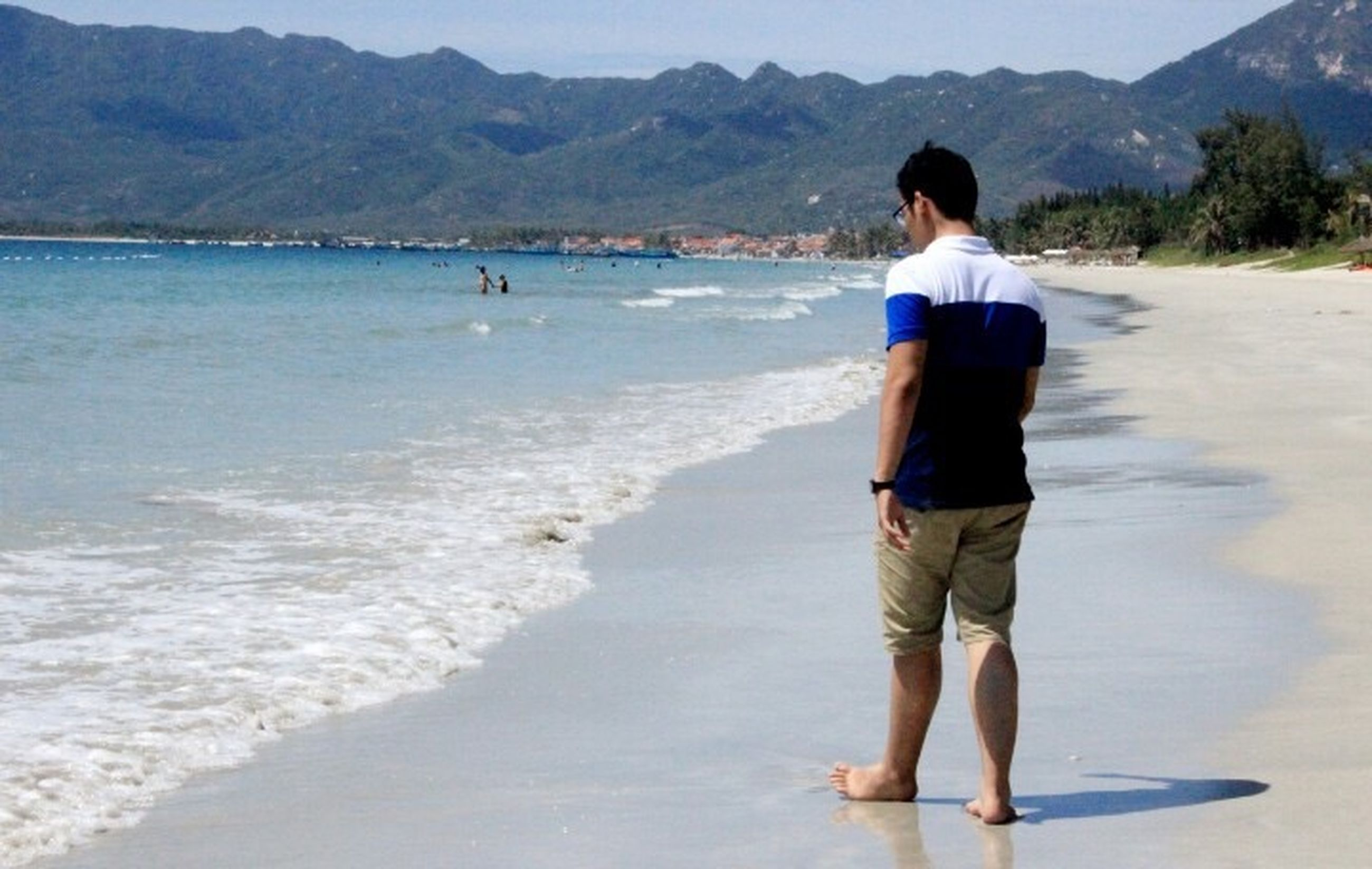 water, beach, mountain, sea, shore, leisure activity, lifestyles, sand, vacations, scenics, casual clothing, nature, beauty in nature, tranquil scene, tranquility, full length, standing, mountain range