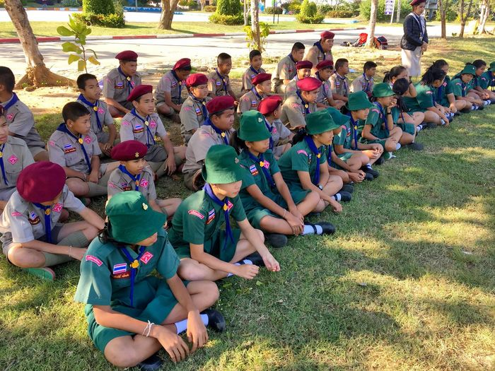Group of boy and girl scout in the scouting uniform sits on the grass Scout Camp Scout Girl Scoutcamp  Club Scout Thailand ASIA Outdoor Sit Scouting Uniform Boy Scout Of Thailand Girl Scout Boy Scout  Scout Photography Scouting Large Group Of People Sitting Day Outdoors Field Grass Togetherness Child Childhood Lifestyles Boys Real People Crowd People Adult