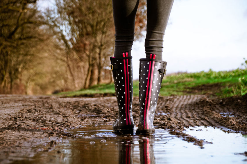 Dotted Gumboots Muddy Waters Puddleography Wellies  Wellington  Close-up Day Dots Human Body Part Human Leg Leisure Activity Lifestyles Low Section Mud Muddy Nature One Person Outdoors People Points Puddle Puddle Reflections Real People Reflection Rubber Boots Scored Sky Standing Tree Walking Water Wet