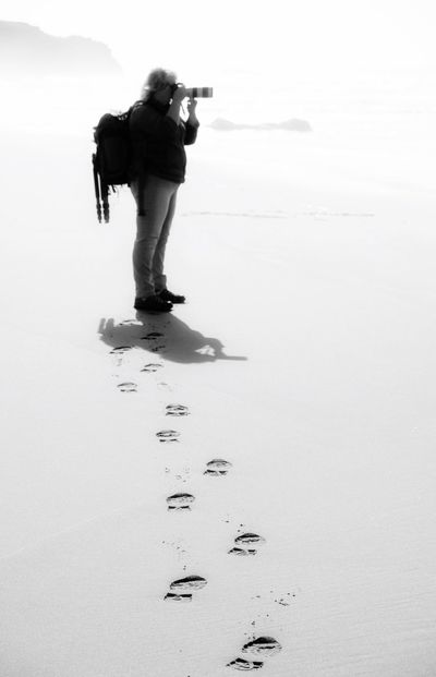 Full Length One Person Sand Standing Beach Holding Day Outdoors Real People Woman Photographer Black And White Camera Hobby Photography Nature Adult People
