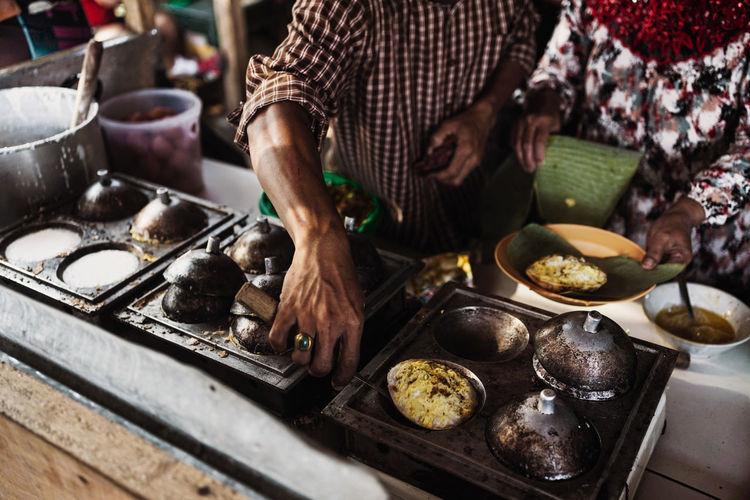 A chef cooks surabi, sundanese traditional food