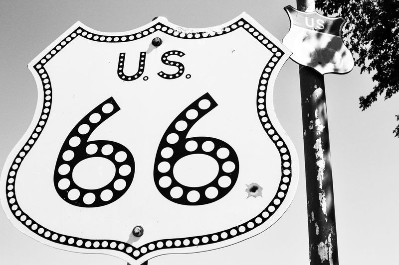 Miles Away Text Close-up No People Day Outdoors Historic Route 66 Sign Blackandwhite Welcome To Black