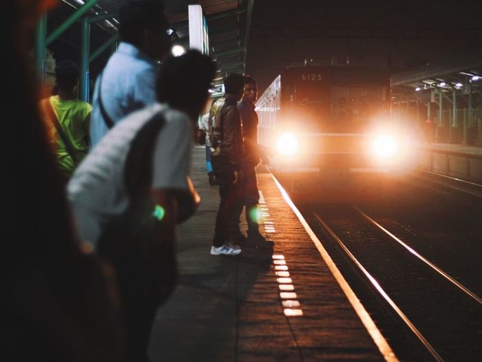 Train arrival Real People Railroad Station Lifestyles Men Public Transportation Railroad Station Platform Illuminated Transportation Railroad Track Rail Transportation Person Group Of People Large Group Of People Commuter Night Crowd People