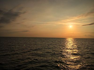 Sunsets make me always peaceful. 🙌🏻❤️ Water Sunset Sea Sky Scenics - Nature Beauty In Nature Horizon Over Water Tranquility Horizon Sunlight Sun Reflection Idyllic Tranquil Scene Orange Color Seascape Nature Cloud - Sky Outdoors