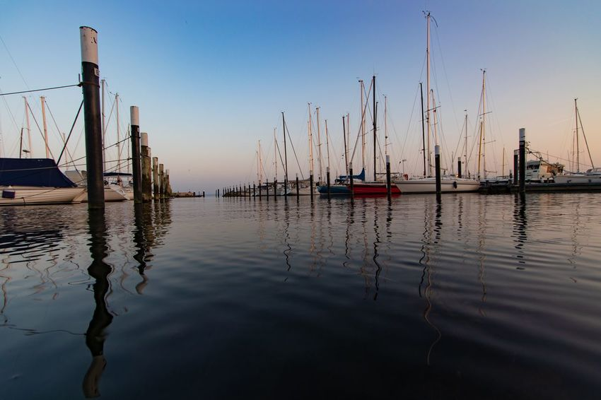 Strandet Hafen EyeEm Selects Water Sky Nautical Vessel Transportation Reflection Nature Mode Of Transportation No People Sailboat Clear Sky Tranquility Outdoors Pole Scenics - Nature Moored Waterfront Harbor Day Sunset Wooden Post