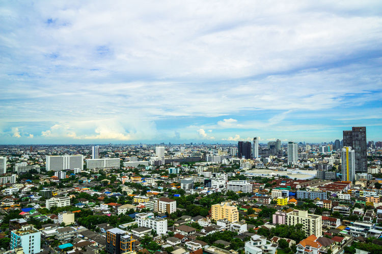View of buildings and houses from above Architecture City Cityscape Horizontal Panorama Panoramic Residential  Scenic Skyline TOWNSCAPE Thailand Towers And Sky Above The City Aerial View Bankgkok Building Capital City High Angle Horizon Landscape Metropolitan Office Building Scene Skyscraper Town