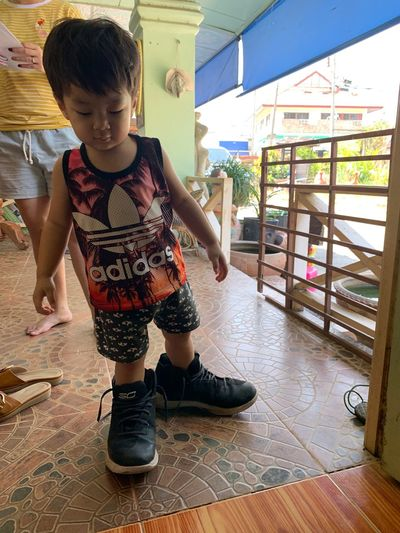 Childhood Child Real People One Person Full Length Lifestyles Casual Clothing Flooring Boys Front View Cute Males  Females Leisure Activity Standing Indoors  Women Girls Innocence Tiled Floor