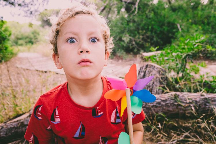 Portrait of boy holding pinwheel toy