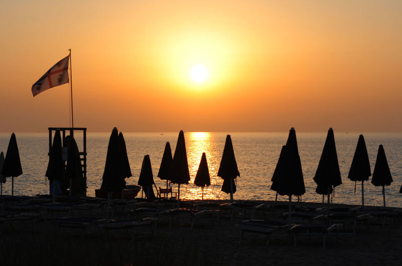 Silhouette of beach umbrellas on beach