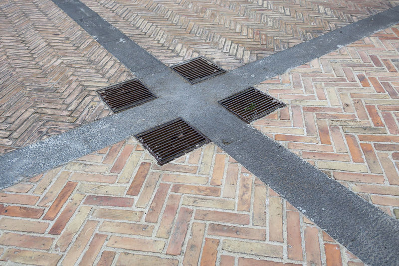 parement with cross Manhole Cover Close-up Cross Cross Shape Cross Shaped Day Design Fishbone Floor Footpath Full Frame High Angle View Metal No People Pattern Pavement Shape