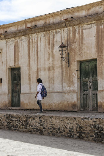 Rural School Architecture Backpack Building Exterior Built Structure Casual Clothing Childhood Full Length Girl One Person Outdoors Real People School School Life  SchoolUniform Walking