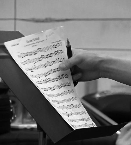 Cropped image of hands holding musical note