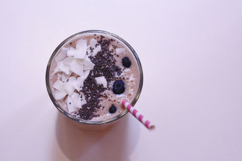 Smoothie Drink Chia Seeds Breakfast Eat Food Food And Drink Coconut Blueberries Cup Glass Straw Table No People EyeEm EyeEm Best Shots Popular Photos Check This Out Photooftheday Freshness Drinking Glass Healthy Eating Ready-to-eat Day Close-up