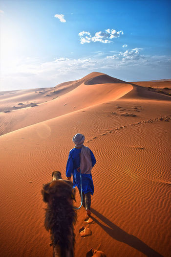 Camel Camel Riding Desert Dunes Dunes Of Merzouga Guide Merzouga Morocco Orange And Blue Summer Sun
