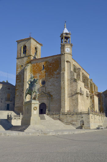 Cáceres Pizarro SPAIN Statue Trujillo Architecture Belief Blue Building Building Exterior Built Structure Clear Sky Clock Conquer Day History Nature No People Outdoors Place Of Worship Religion Sky Spirituality The Past Tower