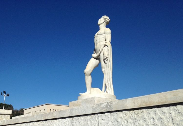 Sculpture Statue Human Representation Art And Craft Male Likeness Low Angle View Day Built Structure Building Exterior Outdoors No People Clear Sky Fine Art Statue Sky Cultures Marble